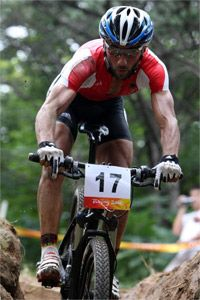 Extreme Sports Image Gallery Manuel Fumic of Germany competes in the men's cross-country mountain-biking event at the 2008 Olympics. If Fumic is any indication, mountain biking can whip you into shape.