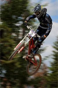 Rider Evan Turpen soars over spectators as he descends the course in the Men's Pro Downhill at the 2009 U.S. Mountain Bike National Championships.