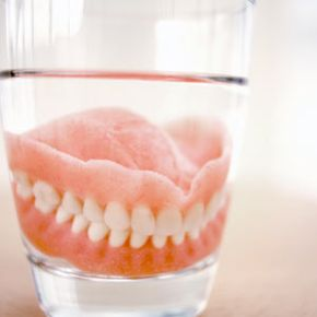 You should always take your dentures out at night and soak them in a denture cleaner or soap to keep them moist and help them retain their shape.