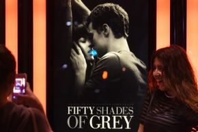 """The classic man-cradles-woman's-head pose, made trite by Nicholas Sparks's film posters, perpetuated by """"Fifty Shades of Grey"""" poster designers."""