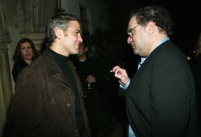 """George Clooney chats with fellow producer Bob Weinstein. The pair produced """"Far From Heaven,"""" which was nominated for four academy awards."""