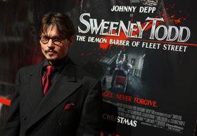 johnny depp actor in front of sweeney todd poster