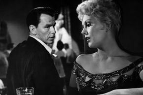 "Frank Sinatra and Kim Novak get up to something shady in the 1955 film ""The Man with the Golden Arm.""  Despite not being approved by the Hays Code, this film was a hit and helped usher in the current MPAA ratings system. Want to learn more? Check out these Movie Making Pictures."