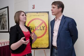 "Katy Butler, the 17-year-old high school student whose campaign to get the MPAA to change the ratings of the movie ""Bully"" from an R to PG-13, poses with newscaster Terry Moran at a screening and discussion of the movie hosted by the MPAA."