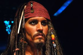 """We're not talking about this kind of movie piracy!  But Johnny Depp's movie did receive a PG-13 rating for """"Intense Sequences of Adventure Violence."""""""