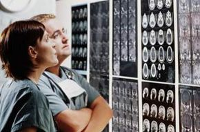Doctors examine the contrasts on an MRI scan.
