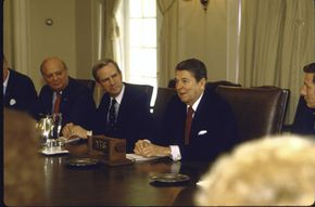 """President Ronald Reagan and SDI supporters discuss the """"Star Wars"""" program supporters in the White House Cabinet Room."""