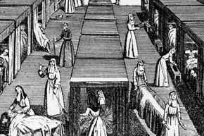 A print of sisters at work in a convent hospital, circa 1650.