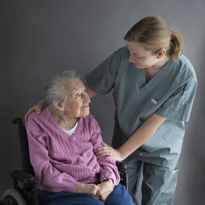 An elderly woman and her caregiver