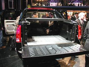 The Cadillac Escalade EXT -- with the seats and rear hatch folded down, the bed can hold a 4x8-foot sheet of plywood.