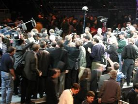 There are more than 5,000 journalists here at the show, all clambering for a good photo or interview. Believe it or not, there is a car under there.