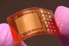 """纳米电磁器看起来像微小的电路板,可以通过简单的挤压产生电流。查看更多电子零件图片。""""width="""