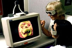 Doctors work with a high-resolution 3D image of a human skull at the NASA Ames Research Center in 1998.