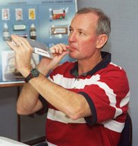 Astronaut Brian Duffy, STS-92 mission commander, samples an orange drink at the JSC. See more astronaut pictures.