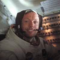 A grinning Neil Armstrong inside the Lunar Module the day he was the first person to step on the moon.