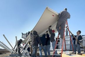 University of Iowa students help to install the NASA NPOL radar as part of the IFloodS program. See Hurricane Sandy pictures.