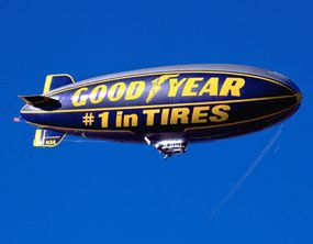 A Goodyear blimp hovers over a sporting event -- a familiar sight that goes all the way back to 1925.