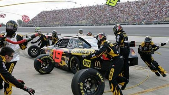 Why don't they use normal air in race car tires?
