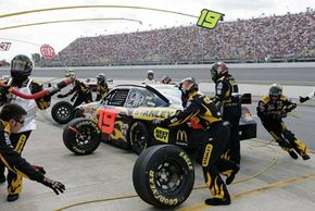 The #19 Stanley Dodge, driven by Elliott Sadler, makes a pit stop during the NASCAR Sprint Cup Series 3M Performance 400 at Michigan International Speedway on August 17, 2008 in Brooklyn, Mich.