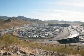 """Phoenix International Raceway is noted for its curved backstretch, called """"the dogleg."""""""