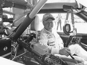 """Cale Yarborough in 1983, before TV broadcasts got fancy. Yarborough said, """"As far as I'm concerned, CBS can put a camera in my car anytime."""""""
