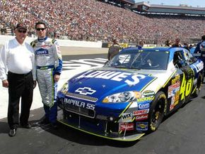 NASCAR driver Jimmie Johnson poses in front of his Car of Tomorrow Chevrolet Impala SS at the Bristol Motor Speedway.