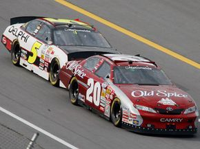 Dale Earnhardt Jr. drafts behind Tony Stewart during the Aaron's 312 NASCAR Nationwide Series auto race at Talladega Superspeedway in Talladega, Ala.