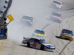 Dale Earnhardt Jr. spins after a blown tire, causing a yellow flag during a NASCAR Sprint Cup Series race at Dover International Speedway in Dover, Del. See more NASCAR pictures.