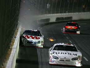 During a turn, centrifugal force pushes the car toward the outside of a curve (and often into the wall, as it did to David Reagan in this 2007 race at Lowe's Motor Speedway).