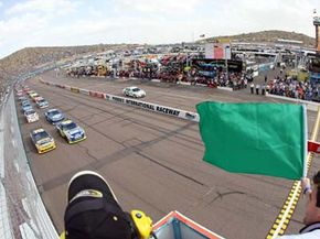 Stock cars -- like the ones shown here at the Phoenix International Speedway in November of 2008 -- are inspected with great care to make sure they conform to the NASCAR's strict standards.