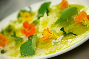 Nasturtium flowers add color and flavor to a meal.
