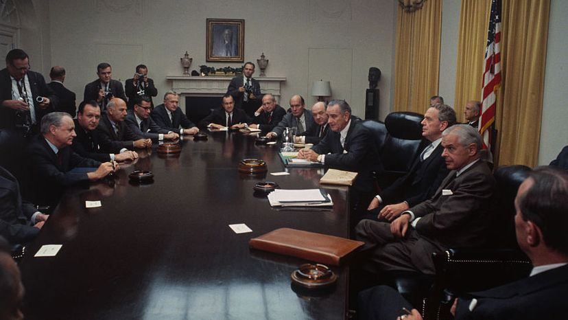 President Lyndon Johnson (fourth from right) meets with the National Security Council and other top government officials, including the Joint Chiefs of Staff at the White House, prior to a scheduled nationwide television report on the Vietnam War in 1968. Bettman/Getty Images