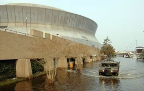 A National Guard Humvee departs the New Orleans Superdome in Louisiana after Hurricane Katrina