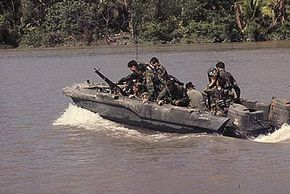 Republic of Vietnam, November 1967: Members of U.S. Navy Seal Team One move down the Bassac River in a Seal Team Assault Boat (STAB) during operations along the river south of Saigon.