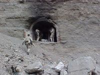 Afghanistan, 2002: SEALs explore the entrance to a cave used by al-Qaeda and Taliban forces.