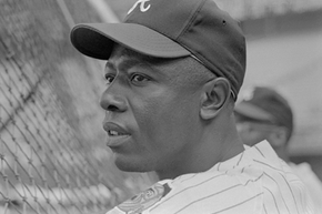 """""""Hammerin' Hank"""" Aaron, the homerun king, pictured here late in his career with the Atlanta Braves, started as a teen in the Negro Leagues. He was the last regular MLB player to have started in the Negro Leagues."""