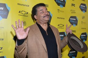 Tyson recreates his 'that's my man, right there' pose, which has become an Internet meme.