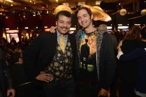Wearing one of his signature astronomy-themed vests, Neil deGrasse Tyson (with filmmaker Jason Silva) attends the premiere of 'Cosmos: A SpaceTime Odyssey' at The Greek Theatre on March 4, 2014 in Los Angeles.