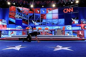 A worker prepares the stage for a debate sponsored by CNN and the Republican Party of Arizona at the Mesa Arts Center, Arizona in 2012.