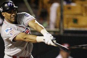 A baseball player shatters his bat