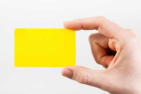 Try using an eyecatching color or shape for your business card to help it stand out.