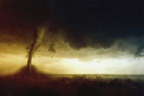 Nope, you can't outrun a tornado. Your best bet is to shelter in place.