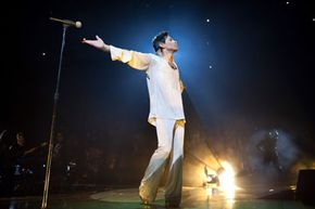 """Musician Prince performs onstage during the """"Welcome 2 America"""" tour at The Forum on May 29, 2011, in Inglewood, California."""