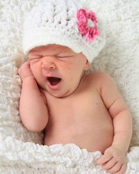 Even if the little one is less than impressed by her new duds, you'll treasure her tiniest newborn outfits.
