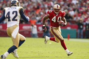 Fred Beasley of the 49ers running the ball. See more football pictures.