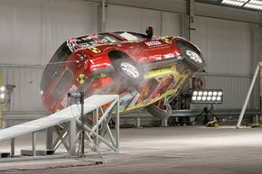 A 2006 Buick Rainier performs a rollover test at a General Motors crash test facility in Milford, Mich., on Dec. 5, 2006.