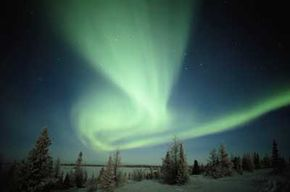 By spending a night in the Alaskan wilderness, you could catch a glimpse of the Northern Lights in the fall and spring.