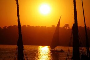 Egyptian Pyramid Image Gallery A faluka, Egypt's traditional sailboat, sails at sunset in the Nile River in Luxor in Upper Egypt.
