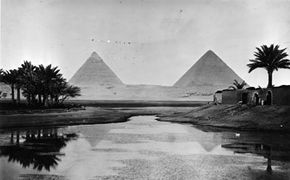 Circa 1900: The pyramids at Giza on the banks of the River Nile, built by the ancient Egyptians to house the bodies of their pharaohs.