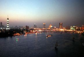A view of Cairo at night shows floating nightspots, five-star hotels and luxury residential and office buildings on the Nile River.
